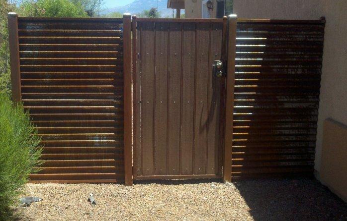 Corrugated Steel Fence with Synthetic Wood Gate | Rusted Metal Fence with Synthetic Wood Gate