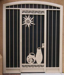 Front door security enclosure E345 with sun and Native American pottery motif - made in tucson