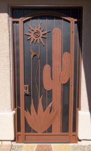 wrought iron security door with saguaro, sun, hummingbird and agave motif E438 - Installed in Tucson