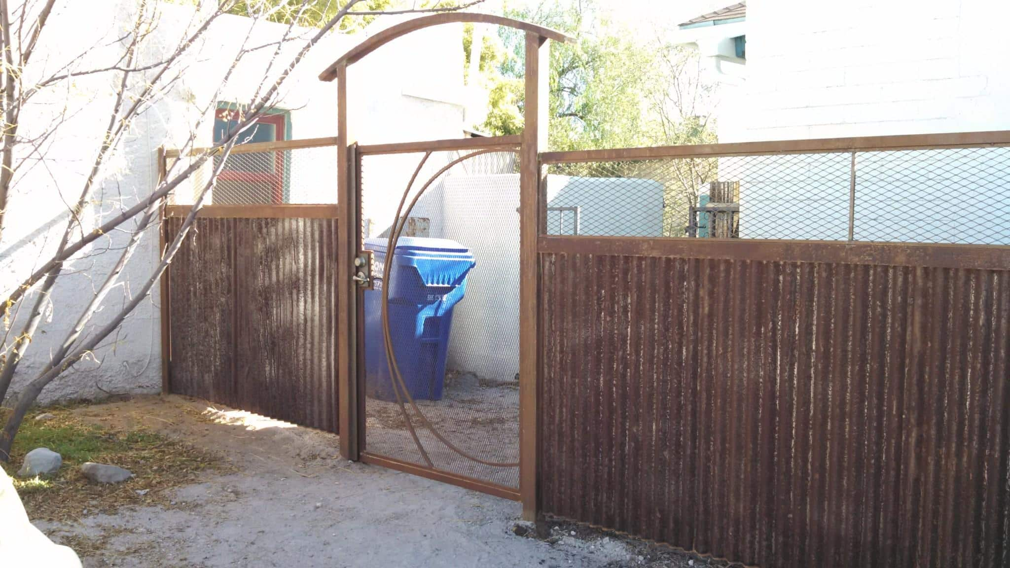 Corrugated Steel Fence | Metal Fence | Rusted Corrugated Metal Fence | Corrugated Steel Fence with Abstract Design Gate