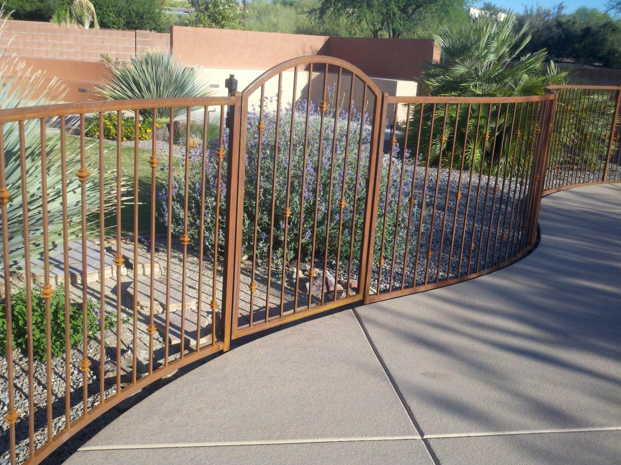Curved wrought iron fence and gate with knuckles IF115 K