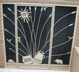 Decorative security enclosure with side panels E346 - Sun, ocotillo, javelinas and Native American pottery motifs - Installed in Tucson