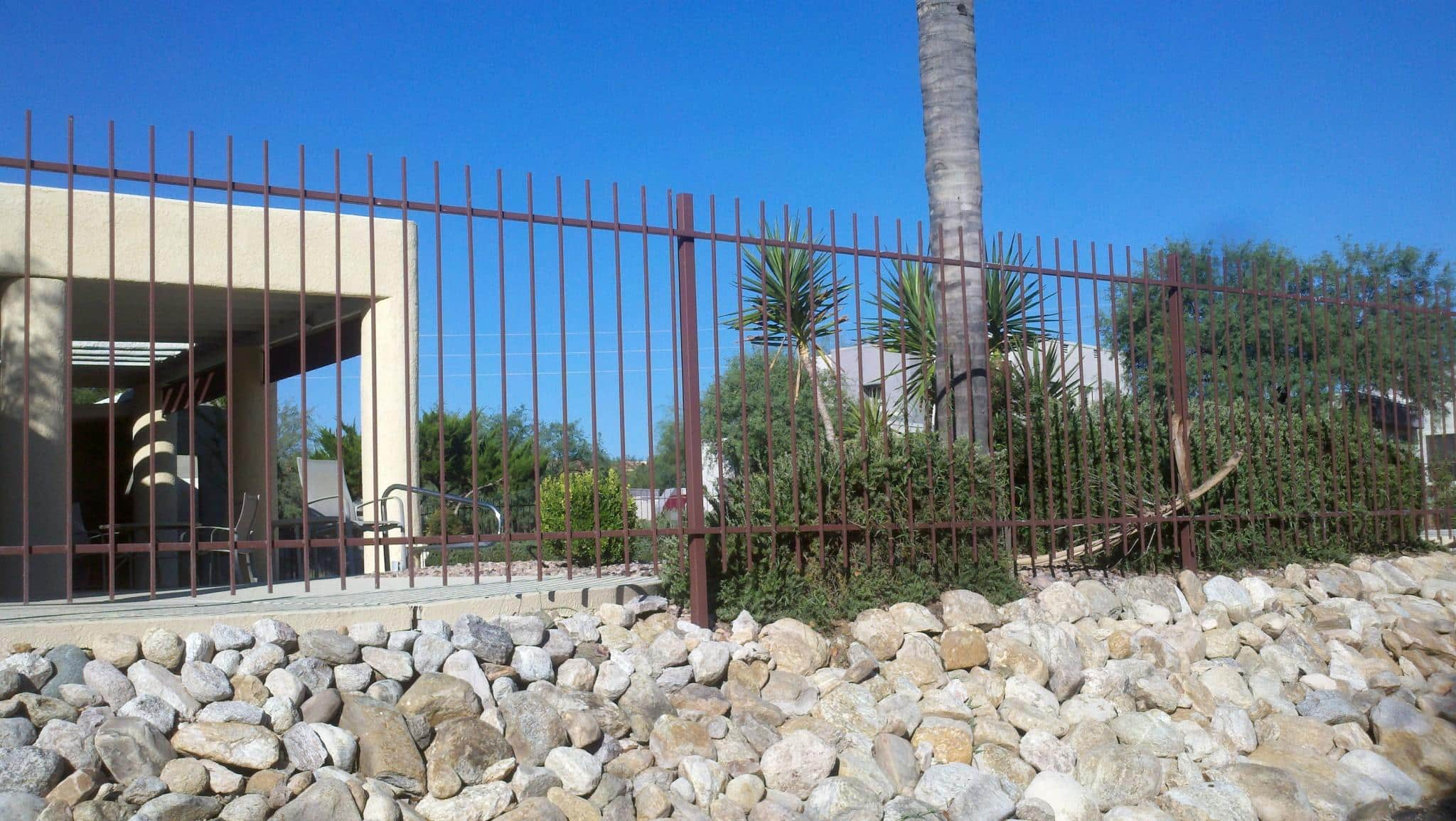This Punched Garden Fence was installed around a concrete deck and a rocade in a subdivision of Marana AZ - IF104-5 EP