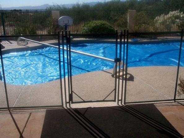 Gate of a mesh pool fence | RM102 | The pool is tarped