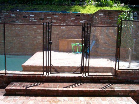 Gate of a wall-mounted mesh pool fence RM107