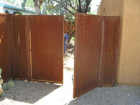 Corrugated Steel Fence | Metal Fence | Rusted Corrugated Metal Fence | Corrugated Steel Fence with a Double Gate