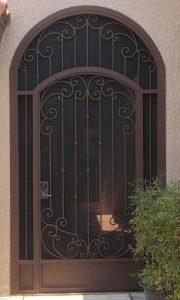 Iron enclosure with scroll work and arched top E917 - Made in Tucson