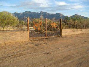 Wall-mounted iron fence and iron gate in wavy rebar with decorative motifs IF304 Rebar - Installed in W Tucson