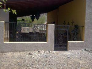 Wall-mounted iron fence and gate with scrolls - Installed in the Foothills of Tucson IF224
