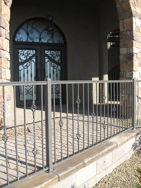 Iron handrail with swirling knuckles and an alternate twist pattern - Custom made for a residence in Tucson IF221-3