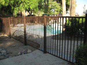 Pool fence with safety bottom rail