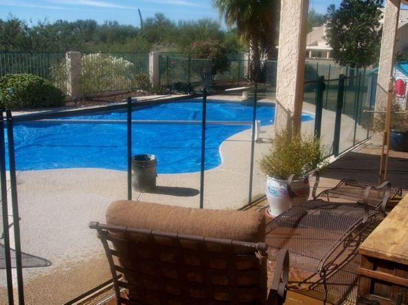 Large curved mesh pool fence that replicates the shape of the pool | RM100