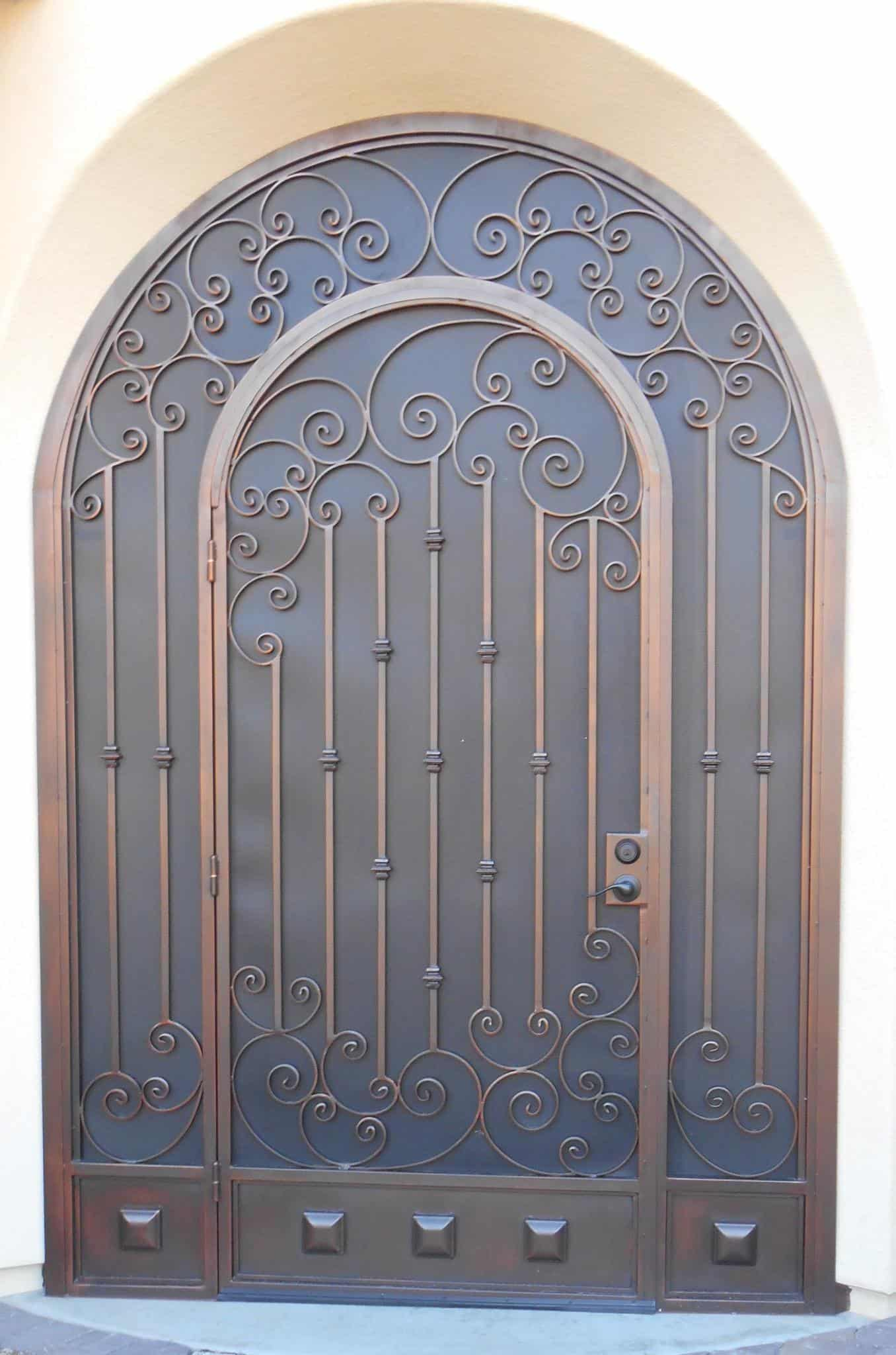 Ornamental security door with knuckles and scrolls E910 - The top is arched - Made in Tucson