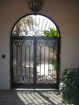 Patio enclosure with double door decorated with swirls and twisted bars E913 - Installed in Tucson
