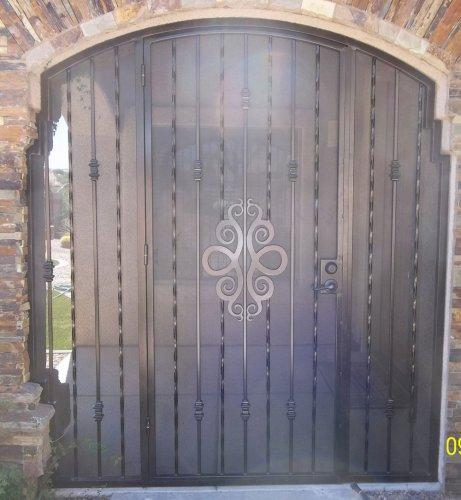 Porch enclosure with ornamental security door E503 with swirls and alternate twist pattern - Made in Tucson