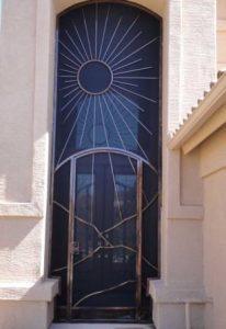 Porch security enclosure - high enclosure with Tucson sun and mountain motifs E343