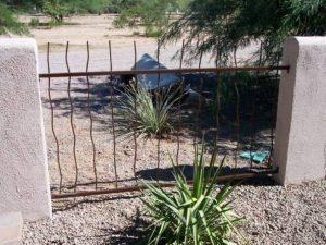 Rust iron fence with wavy rebar with masonry posts IF303 Rebar - installed in Tucson