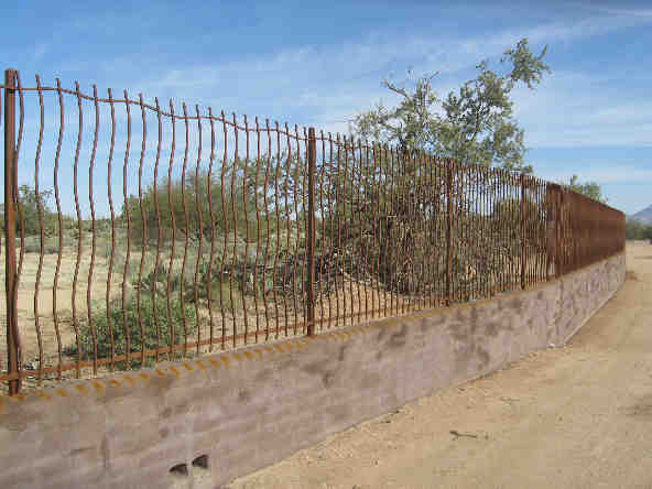 Wall-mounted rust iron fence with wavy rebar IF304-2 Rebar - Installed in W Tucson