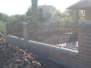 Wall-mounted rusted rebar iron fence IF302 Rebar - Installed in Tucson