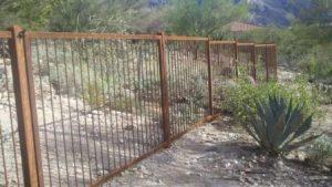 Rusted Wrought Iron Fence Installed over Graded Terrain IF105