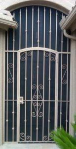 Security door and enclosure decorated with swirls and knuckles E09 - Made in Tucson