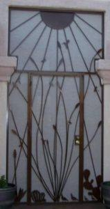 Security door and security enclosure with ocotillo and southwestern motifs. Note how the frame hugs the wall moldings E444 - Made in Tucson