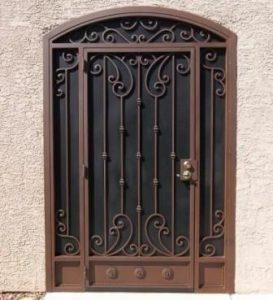 Security door with arched top and decorative knuckles and scrolls E909 - Made in Tucson