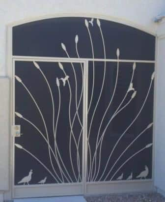 security door with enclosure and ocotillo and quails motifs E342