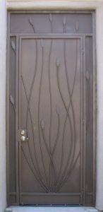 Security enclosure door with decorative ocotillo motif E212