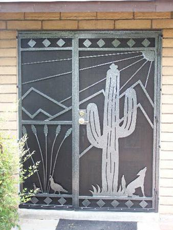 Security enclosure with southwestern decorative motifs: saguaro, quails, coyotes, mountain and sun E439