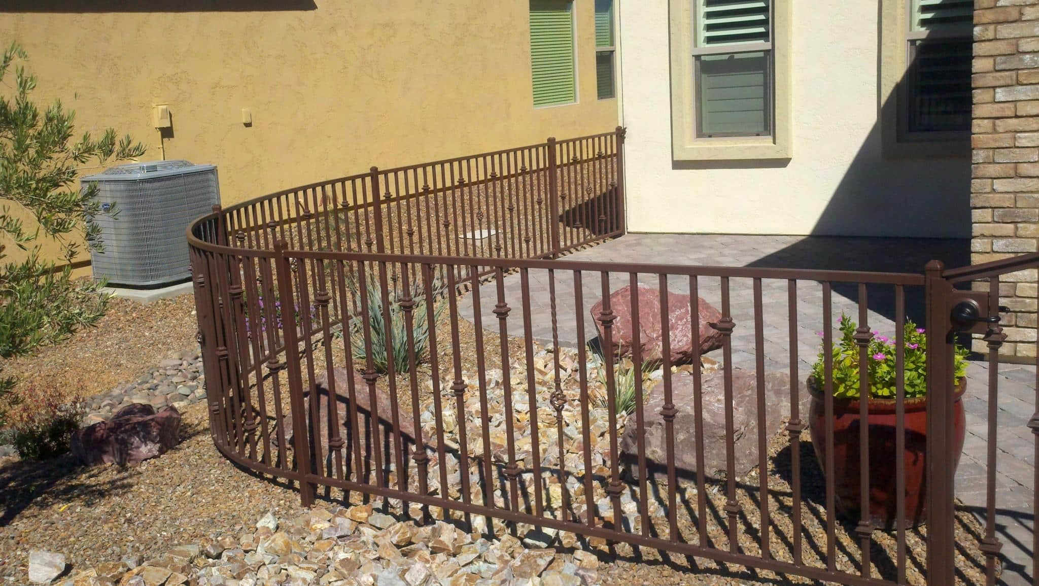 Short rust iron fence with a curve and knuckles - Installed in a Tucson subdivision IF226
