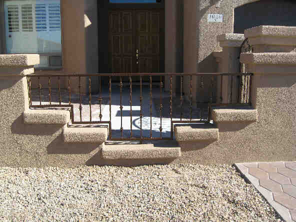 Short stepped wrought iron fence with knuckles IF214