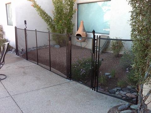 Unusual application for a mesh pool fence used here to protect a small garden RM114