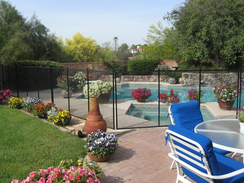 View of a mesh pool fence with a partial perimeter RM112
