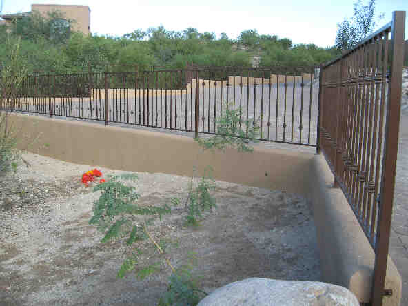 Wall-mounted wrought iron fence with decorative knuckles - Foothills Tucson IF108 K