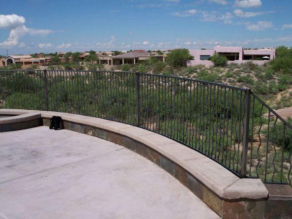 Wall-mounted wrought iron handrail installed in the Foothills over Tanque Verde IF102-6 A/W