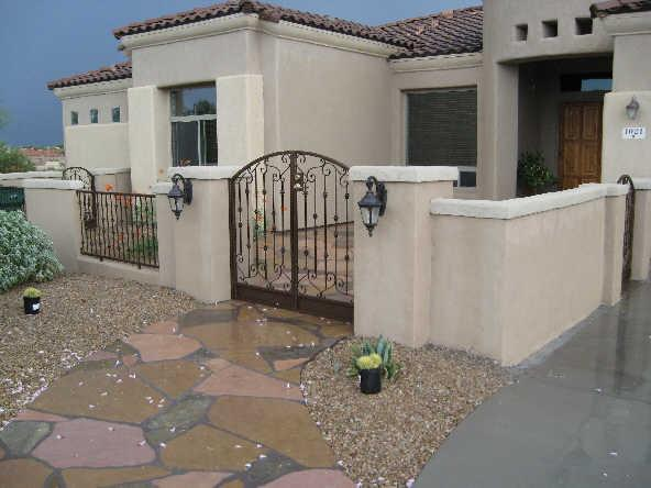 Wrought iron custom arched gate with swirls and knuckles - Tucson IF212