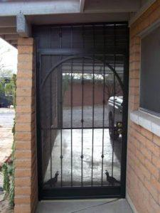 Wrought iron enclosure - single door with knuckles and quail motifs E116