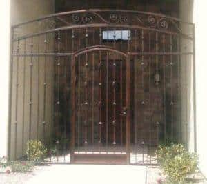 Wrought iron enclosure with knuckles and arched top - Installed in Tucson