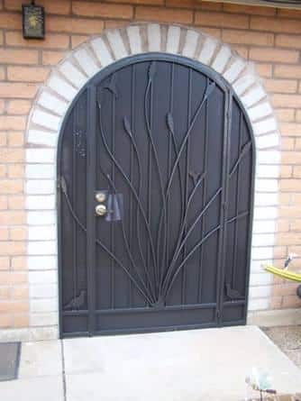 Wrought iron security enclosure with quail and ocotillo motif on security door and side panels - Black E347 - Made in Tucson