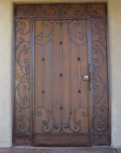 Wrought iron security enclosure with swirls on security door, side panels and top panel E1006 - rust patina - Made in Tucson