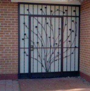 Wrought iron security enclosure with asymetrical side panels and wide ocotillo motif E417-2