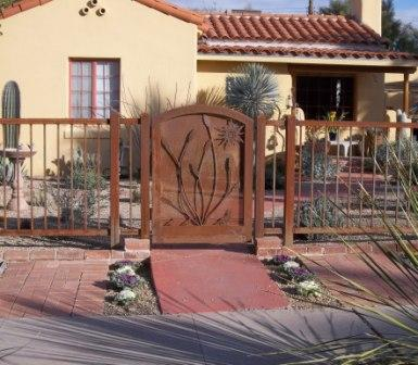 wrought iron arched gate with ocotillo and quail motifs with wrought iron view fence IG336