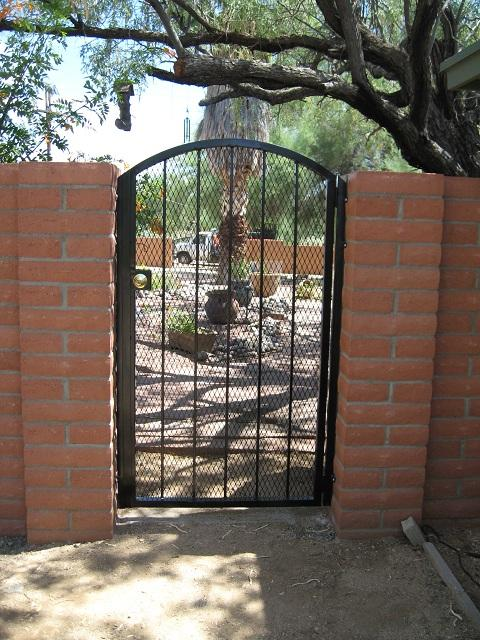 Arched top wrought iron gate with expanded steel backing made in Tucson IG077