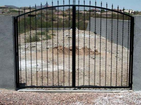 Arched top wrought iron gate with spear points with an expanded steel backing IG080 - Made in Tucson