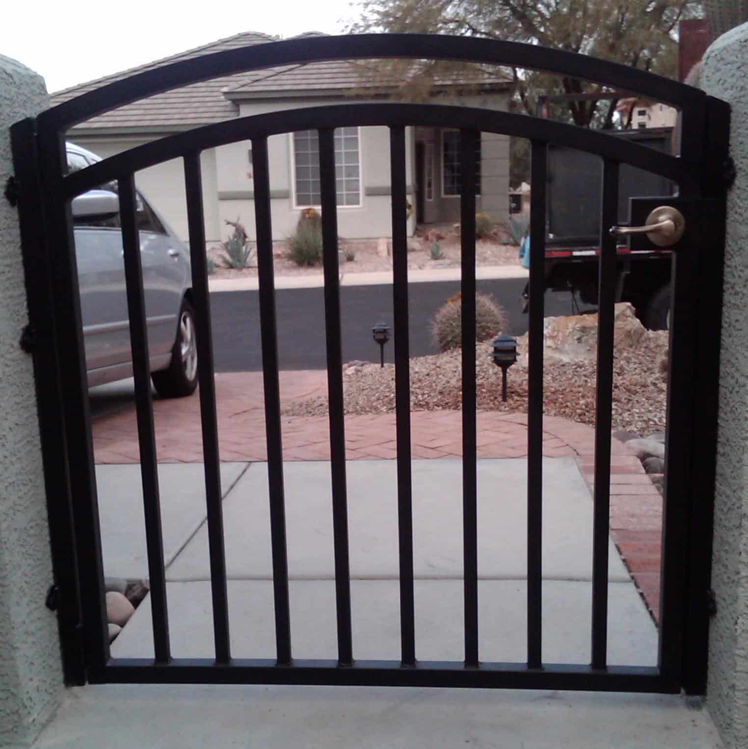 Black arched-top wrought iron gate Tucson IG028