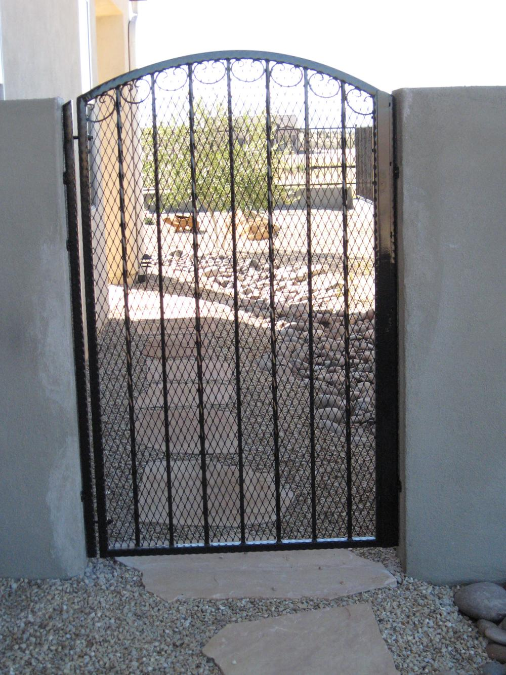 Black hammered wrought iron gate with expanded steel backing made in tucson IG025