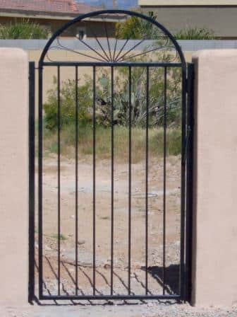 Black wrought iron gate with arched top installed in Tucson IG085