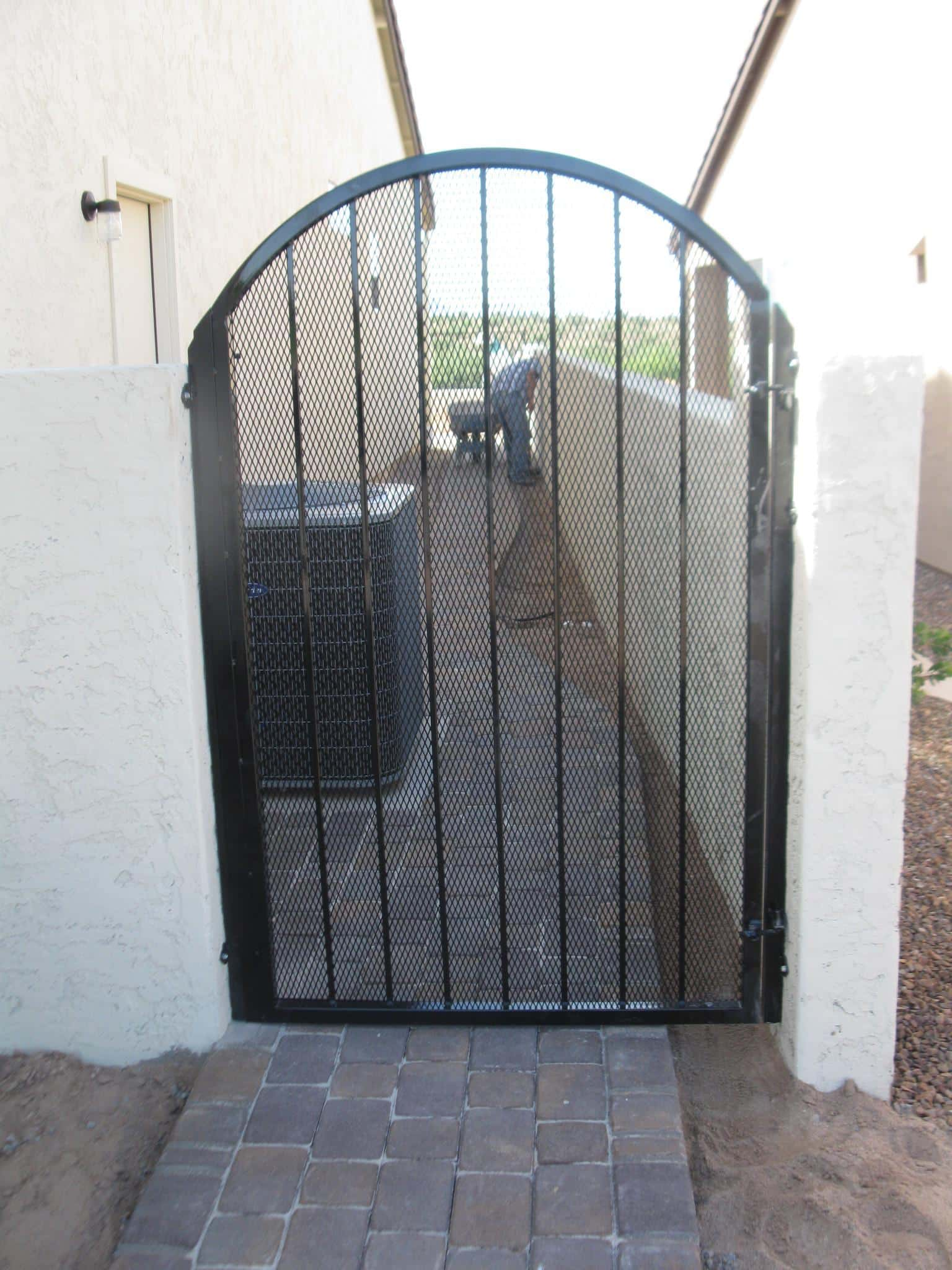 Black wrought iron gate with expanded steel backing IG027