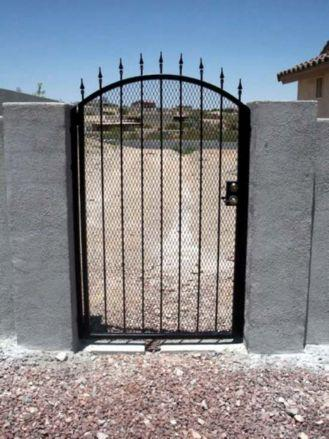 black wrought iron gate with spear tips and expanded steel backing made in tucson IG010